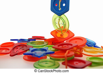 plastic buttons & string