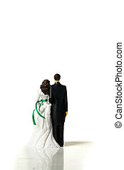 plastic cake-topper wedding couple from the back, on white