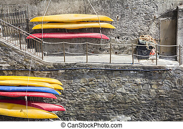 Plastic canoes, hanging on the wall