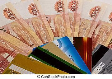 Plastic cards on money background