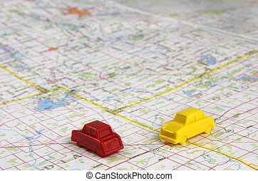 Plastic Cars Intersecting On Map - Yellow and red plastic...