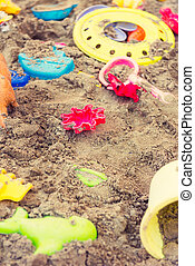 Plastic children toys in sandpit or on a beach