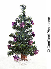 plastic christmas tree with purple stars isolated on white background