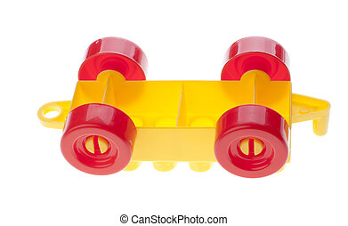 Plastic constructor car upside down. Isolated on white.