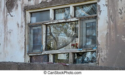 plastic covering windows of a crumbling dilapidated building...