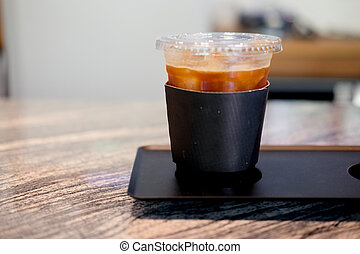 Plastic cup of iced black coffee