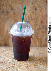 Plastic cup of iced black coffee americano