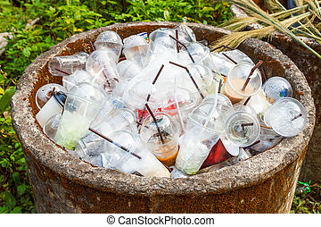 Plastic cups in trashcan.