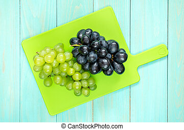 Plastic cutting board with grapes