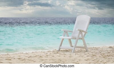 Plastic Deck Chair on Tropical Beach Paradise in the...