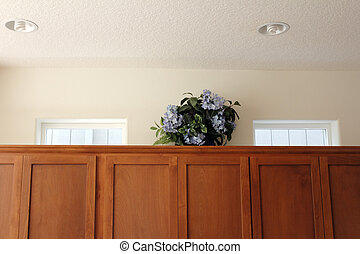 Plastic Flowers on Cabinets