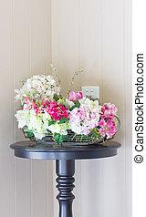 Plastic flowers with modern vase.