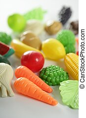 Plastic game, fake varied vegetables and fruits. Children...