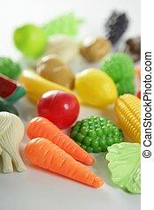 Plastic game, fake varied vegetables and fruits. Children ...