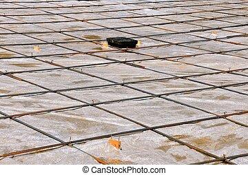 Plastic moisture sheet over sand in a cement floor...
