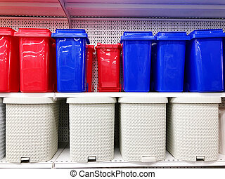 plastic multicolored waste buckets stand on store shelves sold.