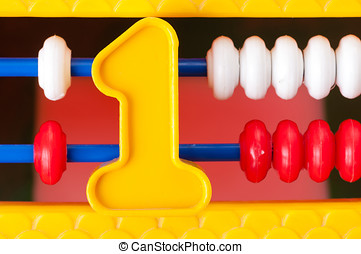 Plastic number one on the background of children's expense