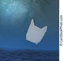 Plastic ocean pollution, white bag underwater. - Plastic...