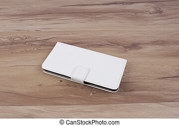 Plastic phone covers n wooden background