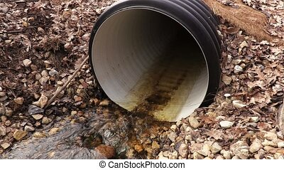Plastic pipe spilling through water