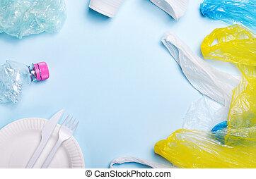 Plastic Pollution Concept, Plastic Litter over Light Blue Background