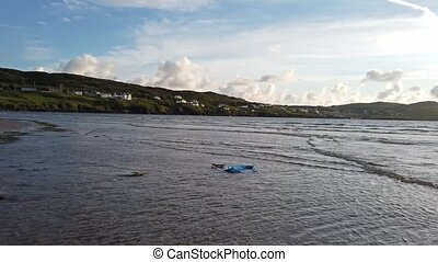 Plastic pollution swimmin in the Atlantic ocean.