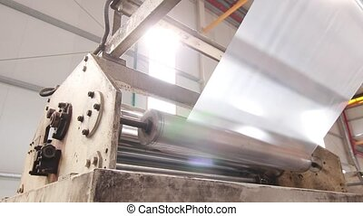 Plastic polymer machine in a factory - Plastic bags factory...