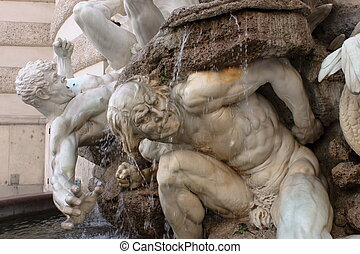 Plastic pose and dramatic expression in this fountain at the entrance of Palace Hoffburg, Wien