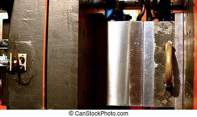 plastic press molding machine work close up