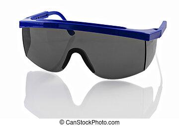 Plastic Safety Glasses - Plastic safety glasses on a...