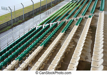 Plastic seats in grandstand at race circuit