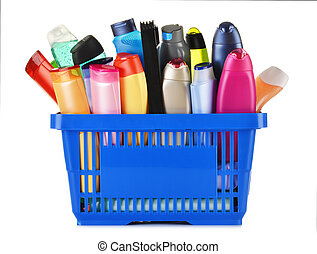 Plastic shopping basket with plastic bottles of body care and beauty products