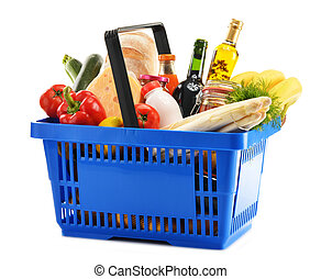 Plastic shopping basket with variety of grocery products...