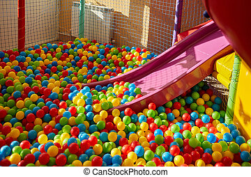 Plastic Slide With Colourful Balls For The Kid's Playground