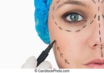 Plastic surgeon marking face
