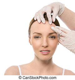 Plastic surgery. Attractive, cute woman