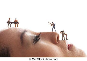 Little figures reconstruct womans face