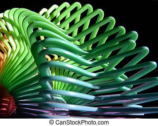 Plastic Swirl - Star shaped plastic slinky toy illuminated...
