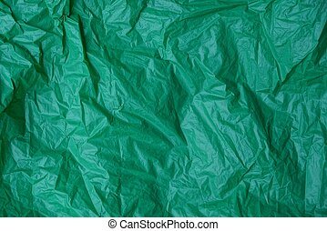 plastic texture of a piece of crumpled green cellophane