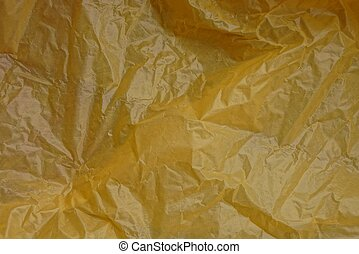 plastic texture of a piece of crumpled yellow cellophane