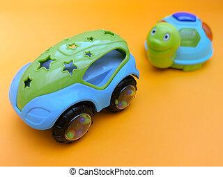 plastic toy blue car, turtle, fast car overtakes, on orange background