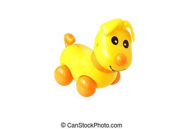 Plastic toy dog. Isolated....