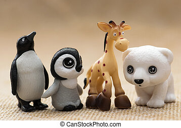 Plastic toy figurines. Penguins, giraffe and white teddy...