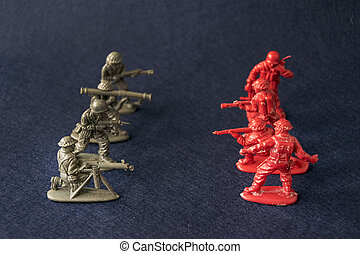 Plastic toy military men at war