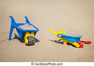 Plastic toys in the sand