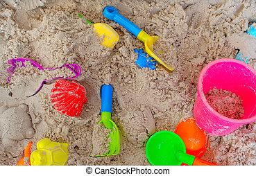 Plastic toys on sand