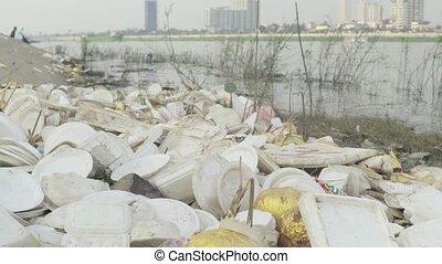 Plastic trash near the Mekong River. Phnom Penh. Asia. Stock...