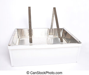 Plastic uncapping tub and sieve on white