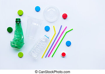 Plastic waste on white background. Top view