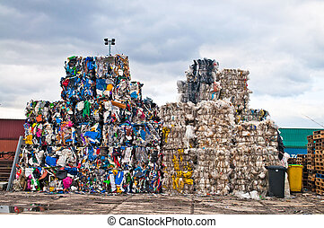 Plastic waste - Piles of colorful plastic waste on a...